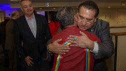 Assemblymember James C. Ramos hugging his brother Ken Ramirez